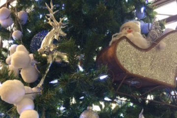 A closeup image of ornaments on a Christmas tree