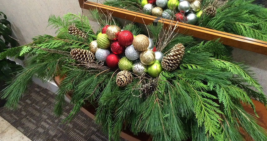 An image of a pot filled with holiday decor