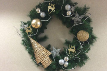 An image of a hanging Christmas wreath